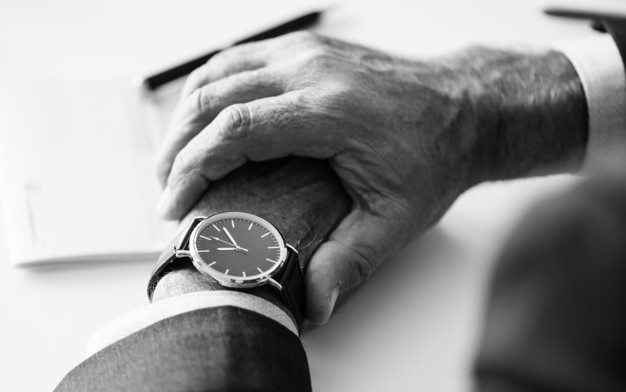 Businessman checking time on hand watch